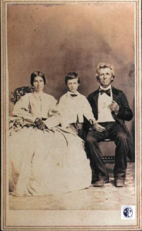 Image: di00019 - George Cox Phillips, wife and son sit for formal family portrait.