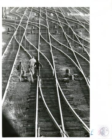 Image: di02273 - boys walking on rails in railroad yard