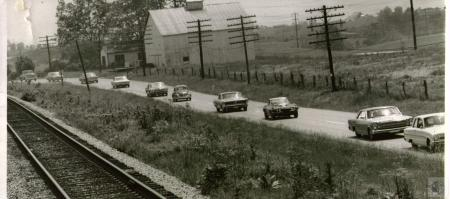 Image: di02280 - Automobiles traveling on unknown road.