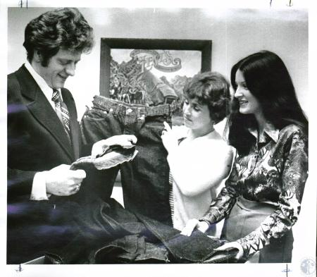 Image: di03717 - Jim (unknown), Nancy Black & Liz Wilder - Jim receiving Levis for Goodwill Store in Covington