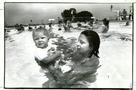 Image: di04570 - Thana Lovings, 9 months, & Jill Golden, 13, swimming at Kenton County YMCA