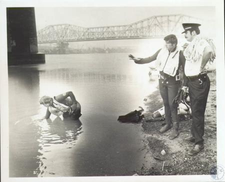 Image: di06728 - Officer Richard Herrmann looks on as divers look for car in Ohio River, diver on right is Dale Appel