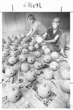 Image: di08428 - Darlene Morales and Jean Miller carve pumpkins.