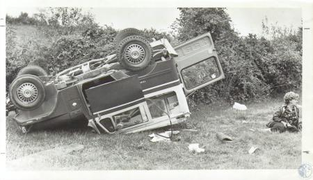 Image: di08758 - Hortense Setters (60) and overturned postal jeep