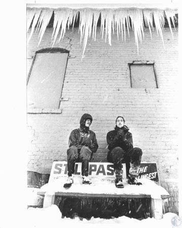 Image: di09637 - Gary Raper (22) and Junior Raper (23) waiting for Tank Bus after work