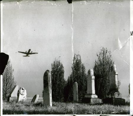 Image: di10062 - jet taking off over grave markers of Boone County pioneers