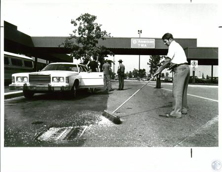Image: di10071 - Mike Hastings, parking lot manager, sweeping glass at scene of