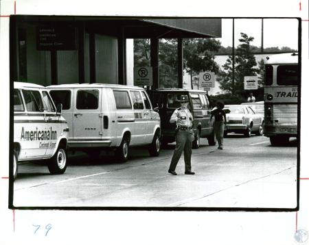 Image: di10073 - John Johnson, airport, directing traffic in front of American Airlines terminal