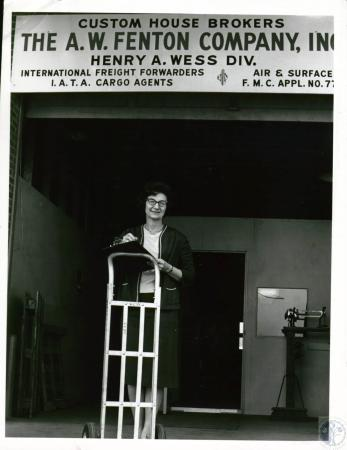 Image: di10108 - Mrs. Rita Holt, office manager for A.W. Fenton, an air freight company that ships worldwide