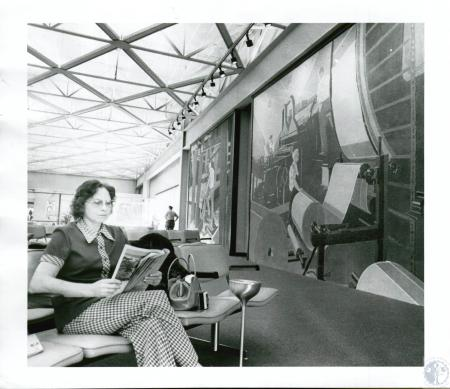 Image: di10125 - Anne Dooley waiting for plane in TWA terminal near murals from Union Terminal