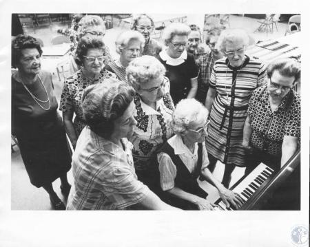 Image: di10245 - Hazel Jones plays piano for residents who join in an impromptu songfest at Grand Towers