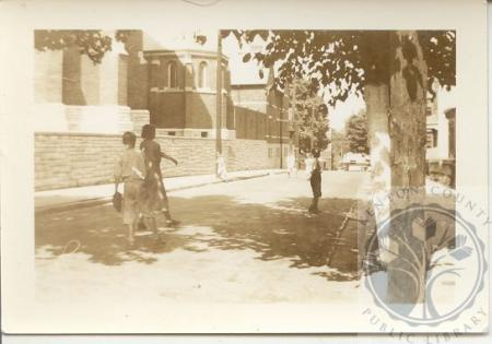 Image: di100100 - boys playing ball on West 11th Street, Saint John's Church to the left