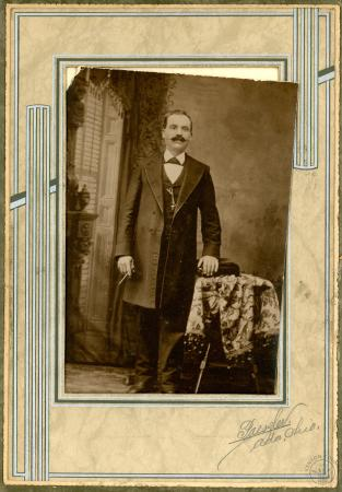Image: di101600 - Unidentified man standing in photo studio (image is the same as di101588, in better condition, but with....