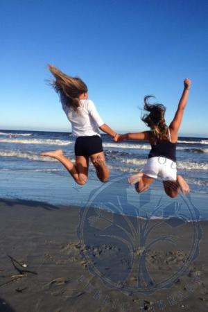 Image: di106314 - Abby and Lilli Nordloh, daughters of Chris and DeLaina Nordloh, enjoying summer vacation at beach.