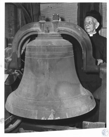 Image: di12229 - Rev. Nicholas Judermanns inspects church bell in preparation for