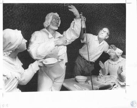 Image: di12251 - Bert Moriconi airbrushing statues in undercroft grotto