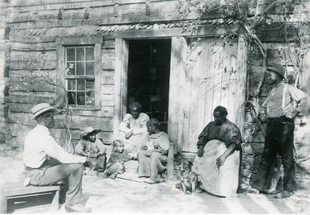 Image: di126445 - Winston Family. Latonia. African American family sitting outside house steps.