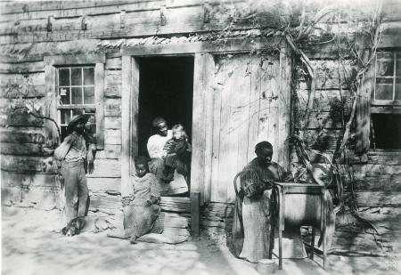 Image: di126446 - Winston Family. Latonia. African American family sitting outside house steps.