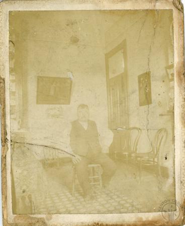 Image: di126448 - Unknown gentlemen sitting in room.