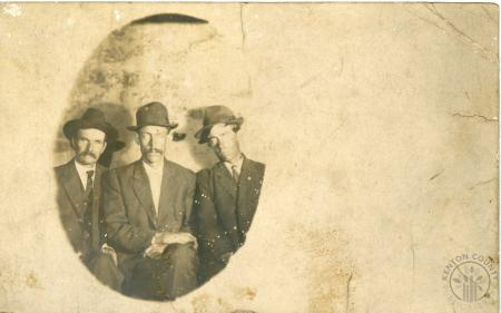 Image: di126449 - Three unknown gentlemen posing sitting with hats.