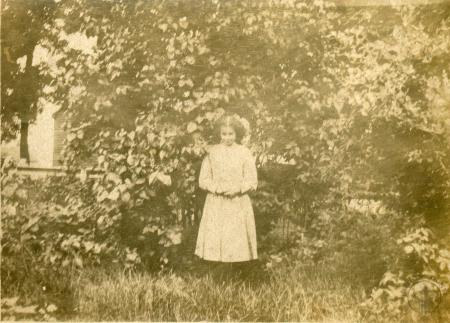Image: di126451 - Unknown girl standing in garden.
