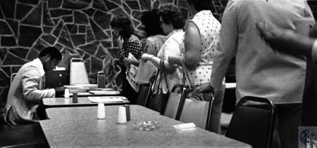 Image: di127829 - Oscar Robertson signs autographs as workers at the IRS center line up in the cafeteria after the Big....