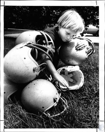 Image: di127965 - Joe Miller, water boy for Bengal Tigers N.Ky Youth Football League, picking up helmets