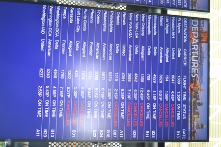 Image: di128343 - Delta Air Lines list of departures showing cancelled flights at the Greater Cincinnati International....