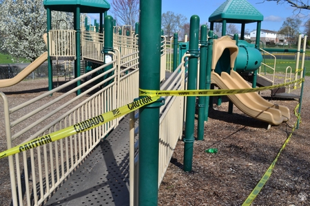 Image: di128364 - Caution tape surrounds play equipment at playgrounds closed due to the corona virus