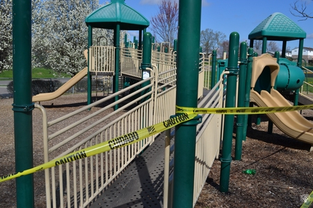 Image: di128365 - Caution tape surrounds play equipment at playgrounds closed due to the corona virus