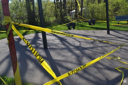 Image: di128366 - Caution tape surrounds play equipment at playgrounds closed due to the corona virus