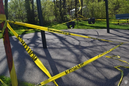 Image: di128367 - Caution tape surrounds play equipment at playgrounds closed due to the corona virus