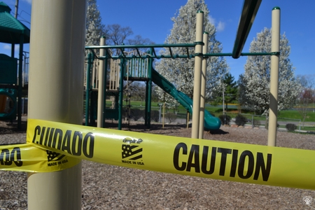 Image: di128368 - Caution tape surrounds play equipment at playgrounds closed due to the corona virus