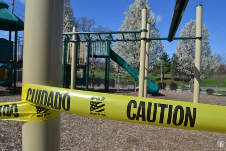 Image: di128369 - Caution tape surrounds play equipment at playgrounds closed due to the corona virus