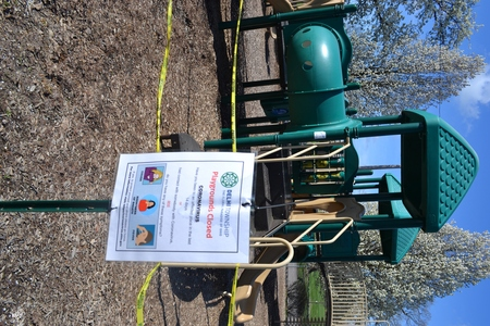 Image: di128371 - Caution tape surrounds play equipment at playgrounds closed due to the corona virus