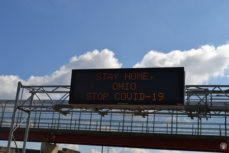 Image: di128374 - Interstate sign on Washington Way warning drivers to stay home to stop the spread of the virus