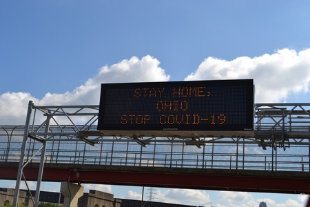 Image: di128375 - Interstate sign on Washington Way warning drivers to stay home to stop the spread of the virus