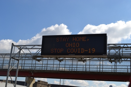 Image: di128376 - Interstate sign on Washington Way warning drivers to stay home to stop the spread of the virus