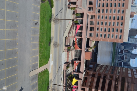 Image: di128407 - View of Embassy Suites with empty road and parking lot