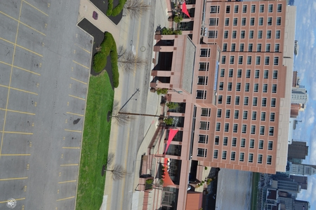 Image: di128408 - View of Embassy Suites with empty road and parking lot