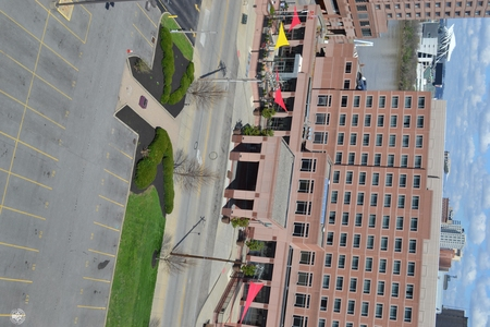 Image: di128409 - View of Embassy Suites with nearly empty road and parking lot