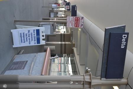 Image: di128425 - Delta Air Lines terminal with coronavirus signage