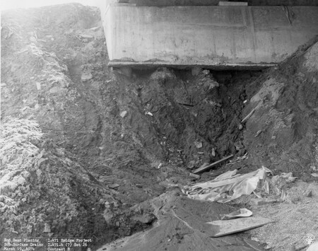 Image: di128730 - End bent placing  sub-surface drains, I-471 bridge project