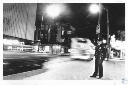 Image: di13237 - Patrolman Henry L. Adams on night shift on Madison Avenue
