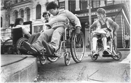 Image: di13261 - Marie Braun, Steve Stiens, Dianne Coroi, Linda Leisling demonstrating lack of handicap accessible ramps....