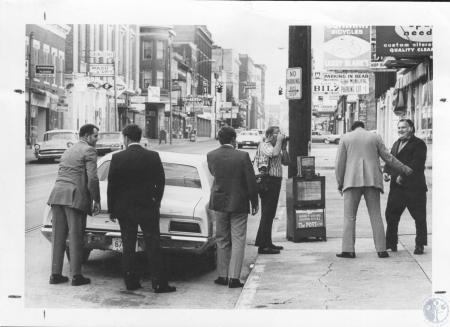 Image: di13286 - ATF agents leading Harold Thonby to car