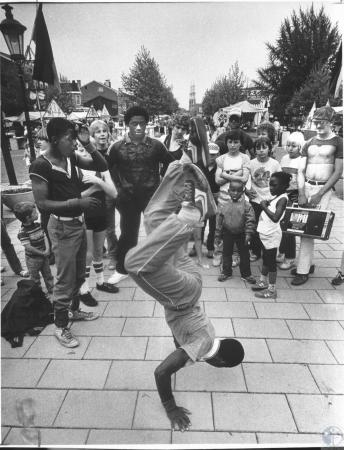 Image: di14373 - Jerome Watts (15) break dances at the Maifest