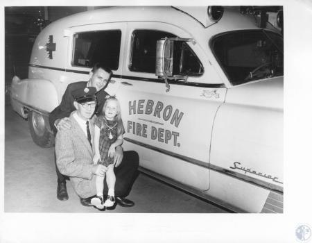 Image: di14401 - William Tanner, Paul Dickman, Paula Grime in front of Hebron Fire Dept. Ambulance