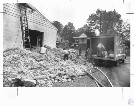 Image: di14633 - Janson and Sons Construction $50,000 to $100,000 loss. Workers waist deep in insulation that was smoldering....