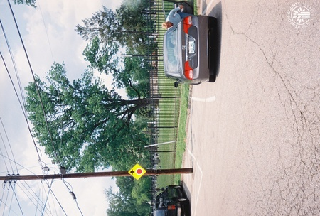 Image: di140081 - View of south side of Linden Grove Cemetery and parking on Linden Avenue.